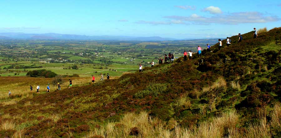 A group of students from the USA descending through the bog after a Sunday morning hike around Carrowkeel.